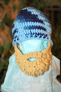 2011/12/2 – My sister Danna had this custom made for my little grandson, Olin. She thought he might like it for the cold winters in Boston. You pull the cap on then pull the tan part down over the face. We thought is was so funny because it is made to look like a beard. We think Logan should put it on Olin and then have a picture taken of the two of them with their man and child beards. I hope he will keep it on long enough for at least one picture.