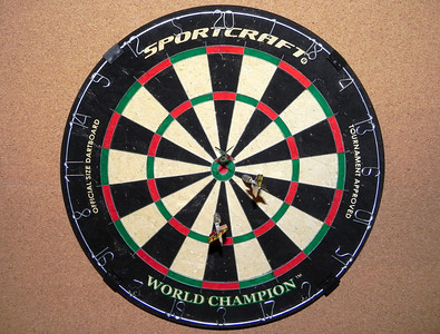 2011/12/10 – This was an early Christmas gift I got for myself. I picked up the tournament quality bristle board about a week ago, then this weekend I built a nice framed cork board and mounted everything in our downstairs family room. Now I can get a little practice for the competition at work.