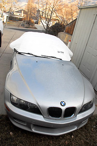 2011/12/16 – Still haven't cleaned out my side of the garage so the Z3 has to be parked on the driveway this winter. To prevent the snow and frost from damaging the convertible top I ordered this California Pop Top. It goes on and off quickly and is made of Tyvek so the ice, water or snow just slides right off. Seems to work great. It is intended to keep the car cool in the summer and prevent the sun from damaging the fabric, so I'll get good use out of it once the warm weather arrives - can't wait for the warmer weather.