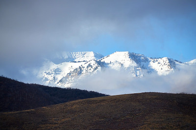 2012-12-06 ––– This is the back side of Mt. Timpanogos. Earlier the fog and clouds were too thick to see the top, but they cleared long enough for me to capture this image.
