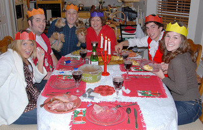 12/24/07 – This is Christmas Eve dinner. We mixed our family traditions with Kristen's family traditions. The colored crowns are Kristen's. We had a great evening eating, playing games and watching movies.