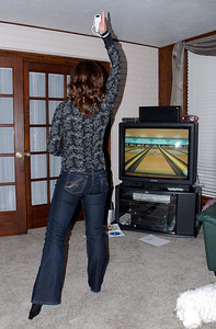 12/25/07 – Photo 6 of 6. We spent Christmas evening playing Wii at my parents' home. We laughed so hard. This is very physical and Jessica (bowling in this shot) is extremely competitive. Nobody beat her in bowling.