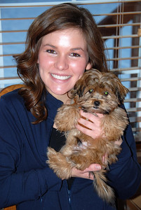 12/16/07 – Kristen and Logan came over for Sunday dinner. Oslo and Chip came as well. Jessica couldn't resist cuddling with Oslo at the dinner table.