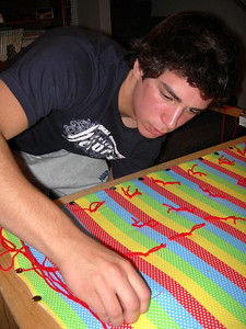 "12/15/07 – Sean wanted to make a quilt for a ""friend"" as a Christmas gift so Lisa set it all up and got him started. He did most of it himself. We hope his ""friend"" appreciated it."