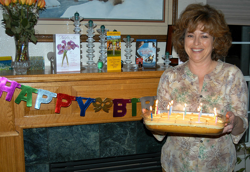 2/25/07 – I know it looks like Lisa is holding a birthday cake but it is actually an anniversary cake. Lisa stopped celebrating birthdays many years ago and now only celebrates the anniversary of her 29th birthday. Don't bother trying to count the candles. They are only ornamentation.