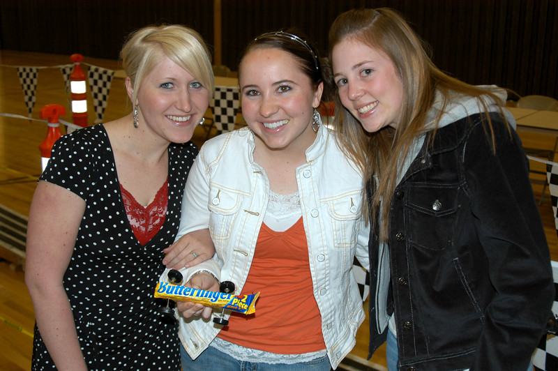 4/13/07 – Tonight we had a closing social for the BYU Ward I serve in. We had a BBQ and Pinewood Derby race. These fine ladies raced my favorite car. It was a Butterfinger candy bar they stuck wheels on. They won an award for the most original design.