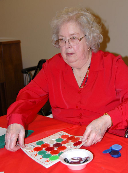 12/21/07 – Today we drove to Logan to see Lisa's parents. In the evening we joined them for a little Bingo action with the rest of the residents at Logan House. Lisa's mom is getting ready to clear her board after a game of Blackout.