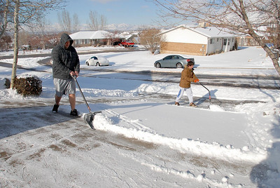 12/25/07 – photo 4 of 6. It snowed Christmas Eve ensuring we had a fresh white Christmas. After brunch Logan and Sean went out to clear the driveway. It was around 20 degrees so I don't know how Logan did it in his shorts.
