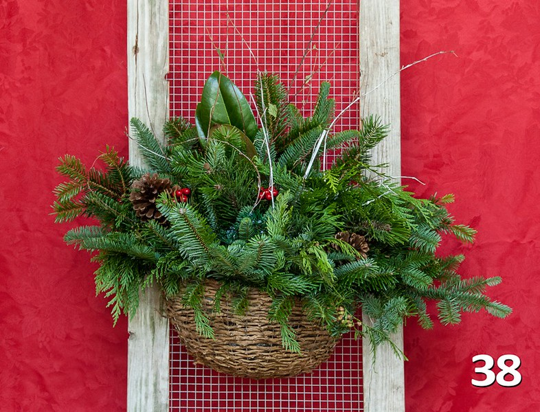#38 - Wicker wall basket full of PNW fresh greens and seasonal accents.