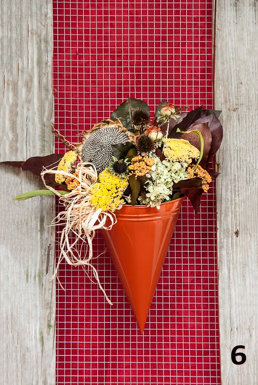 #6 - Burnt sienna metal cone wall planter with Fall botanicals.