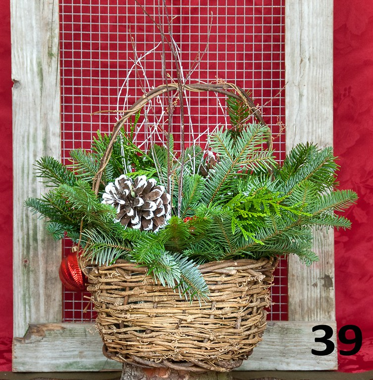 #39 - Large wicker basket full of PNW fresh greens and seasonal accents.