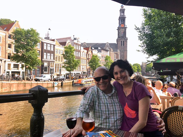 Enjoying our first evening on the canals of Amsterdam.  The Westerkerk church in the background was built between 1620 and 1631.
