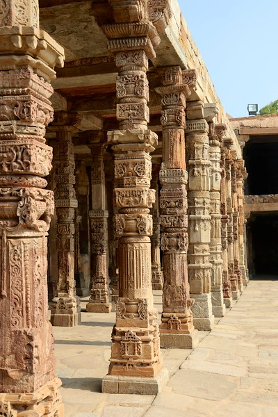 Intricate stone carvings on the cloister columns at Quwwat ul-Islam Mosque, Qutb complex, Delhi