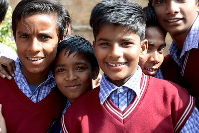 Friendly schoolboys on a field trip at Qutb Minar