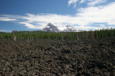 "Lava fields with 2 of the ""Three Sisters"" along McKenzie Pass."