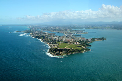 Gorgeous overview of the city of San Juan, the capital of Puerto Rico, founded in 1521 by Juan Ponce de León. The Old Town in the foreground is dominated by the San Felipe del Morro Fort and hotels and beach resorts fill the newer, modern part of town in the background.