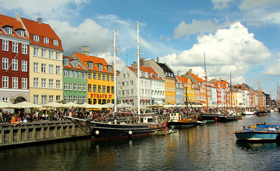 NYHAVN is a 17th century waterfront, canal and entertainment district, lined by brightly coloured 17th and early 18th century townhouses and bars, cafes and restaurants. Copenhagen, Denmark