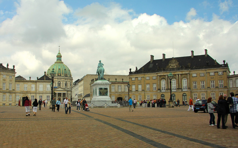 Amalienborg Palace (dating from 1760) is the winter home of the Danish Royal family. It consists of four identical palace façades around an octagonal courtyard with a statue of Amalienborg's founder, King Frederick V in the center. ---Copenhagen, Denmark