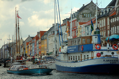 Nyhavn was constructed by King Christian V from 1670-73, and is a gateway from the sea to the old inner city at Kongens Nytorv (King's Square), where ships handled cargo and fishermens' catch. Copenhagen, Denmark