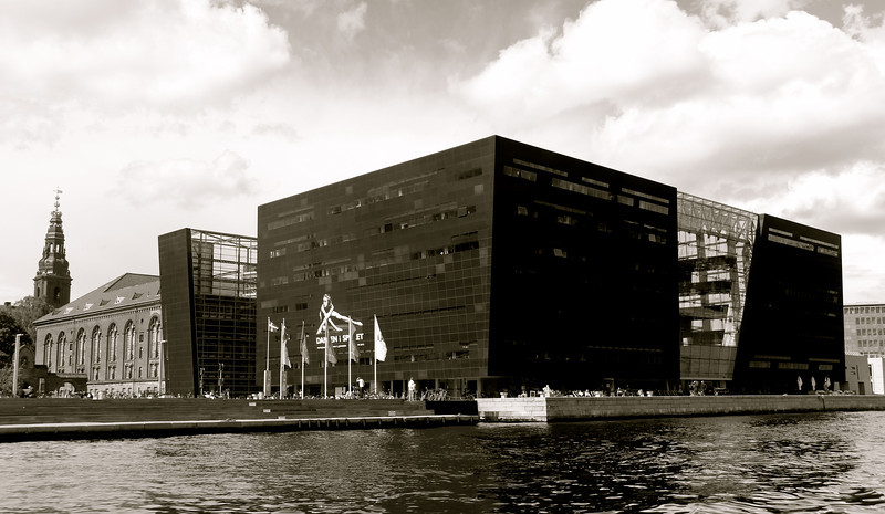 Den Sorte Diamant (The Black Diamond) completed in 1999, is a modern waterfront extension to the Royal Danish Library's old building. Copenhagen, Denmark