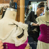Joshua Boucher/Staff Photographer<br /> Janet O'Neill, costume shop manager, tightens a corset that was made for Intimate Apparel on Monday, July 13, 2015. This corset will be worn by Kate Eastman as Mrs. Van Buren.