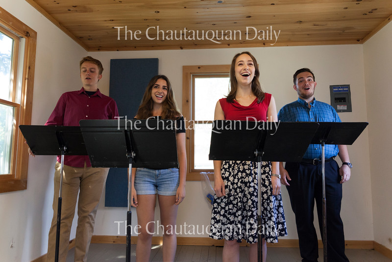 Left to right: voice students Michael Hawk, Kresley Figueroa, Amy Yarham, and Calvet Young pose for a portrait inside a practice shack behind Lenna Hall on June 30. Voice students will perform in the first Wednesday night concert of the season at 7:30 PM on July 6 in McKnight Hall. Photo by Carolyn Brown.