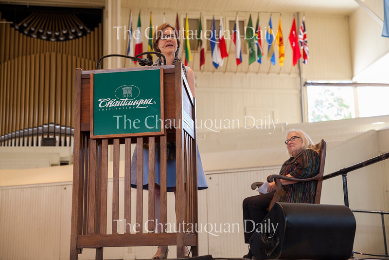 "Author Ann Patchett, left, reads a selection from her upcoming book ""Commonwealth"" as Sherra Babcock, right, vice president and Emily and Richard Smucker Chair for Education, looks on in the Amphitheater on June 30, 2016. The reading followed Patchett's conversation with Roger Rosenblatt, part of the Week One morning lecture series ""Rgoer Rosenblatt & Friends: On Creative Expression."" Photo by Carolyn Brown."