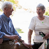 Dick and Margie Buxbaum talk and hold hands while enjoying appetizers at the Chautauqua Property Owners Association Potluck at the Athenaeum Hotel porch on June 22, 2016. The Buxbaums have been coming to Chautauqua for 30 years. On the day of the potluck, they were two days away from their 54th anniversary.
