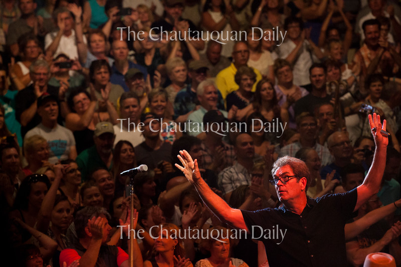 Huey Lewis waves to the crowd during the Huey Lewis and The News concert at 8:15 PM on July 22, 2016, at the Amphitheater. The band played to a sold-out crowd that rushed the stage, sang and danced along, and held up signs in support of the group. Photo by Carolyn Brown.