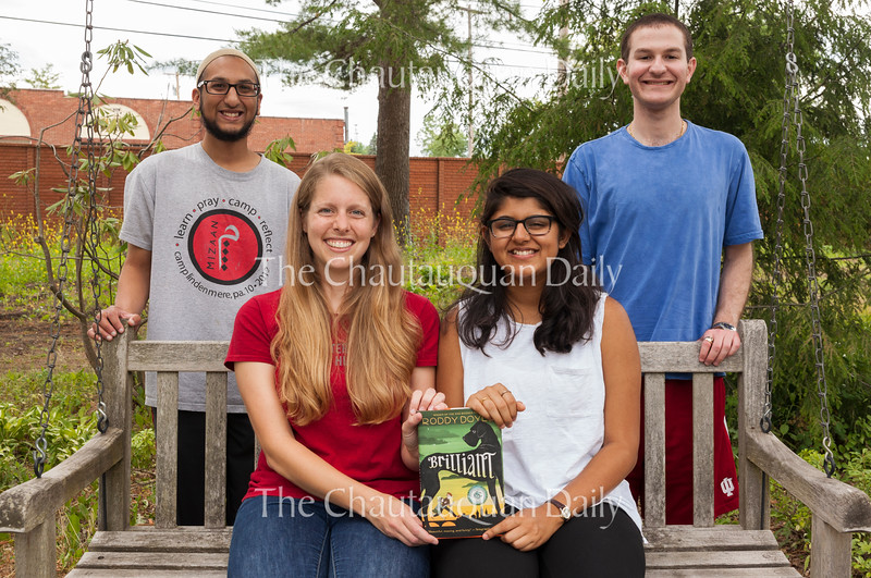 "From left: Yasin Ahmed, Muslim correspondent; Emily Peterson, Christian correspondent; Safia Lakhani, Muslim correspondent; and David Bloom, Jewish correspondent, who make up the Abrahamic Program for Young Adults, pose for a picture at 4:30 PM on July 4, 2016, in the Discovery Garden. Peterson and Lakhani are holding a copy of Roddy Doyle's ""Brilliant,"" a young adult novel about overcoming difficult times, which the group will discuss with the CLSC Young Readers on Wednesday, July 6, at 4:15 PM at Smith Memorial Library. Photo by Carolyn Brown."