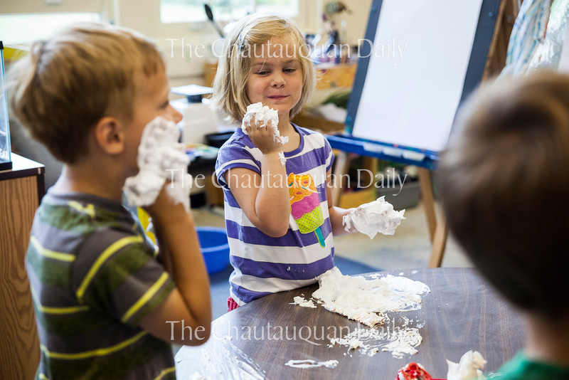 From left: Sam Durkee, five, and Caroline Vincent, five, play with shaving cream at 10 AM on July 18, 2016, in the Yellow Room at Children's School. Before participating in Children's School's Open House, the children and teachers in the Yellow Room did several activities, including playing with shaving cream, playing outside, and practicing the songs they would sing in the program. Photo by Carolyn Brown.
