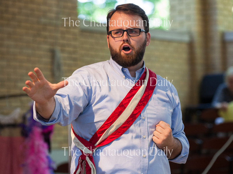 "Baritone Jake Skipworth performs ""Agony"" from Stephen Sondheim's ""Into the Woods"" at the Chautauqua Opera's event ""Hojo-To-Jo! To the Opera We Go!"" at 5 PM on July 19, 2016, at Smith Wilkes Hall.<br /> <br /> At the event, Skipworth and  other members of the Chautauqua Opera Young Artist class of 2016 introduced children to opera by performing famous arias, teaching them opera vocabulary, and involving the audience in the show. Photo by Carolyn Brown."