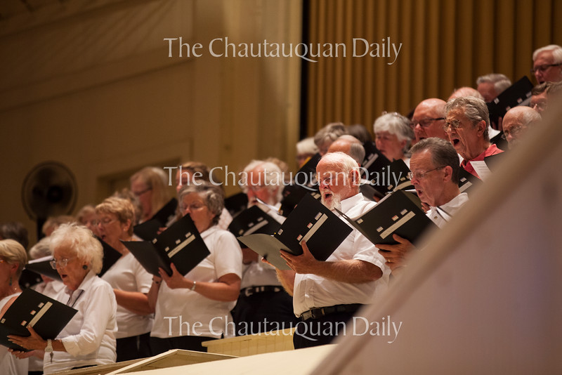 """The Chautauqua Choir sings in the week's Sacred Song Service at 8 PM on July 18, 2016, in the Amphitheater. The service centered around the theme """"Transformation"""" and focused on scenes of transformation in the Bible, such as the conversion of Saul and the Transfiguration of Jesus. Photo by Carolyn Brown."""