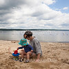 Iona Morris, fifteen months, left, plays in the sand in Children's Beach with her mother Mollie Worth, right, on June 29, 2016. Morris and Worth, who were visiting Children's Beach with Morris's aunt and cousins, spent time at Children's Beach watching ducks, digging holes in the sand, and wading in Chautauqua Lake.