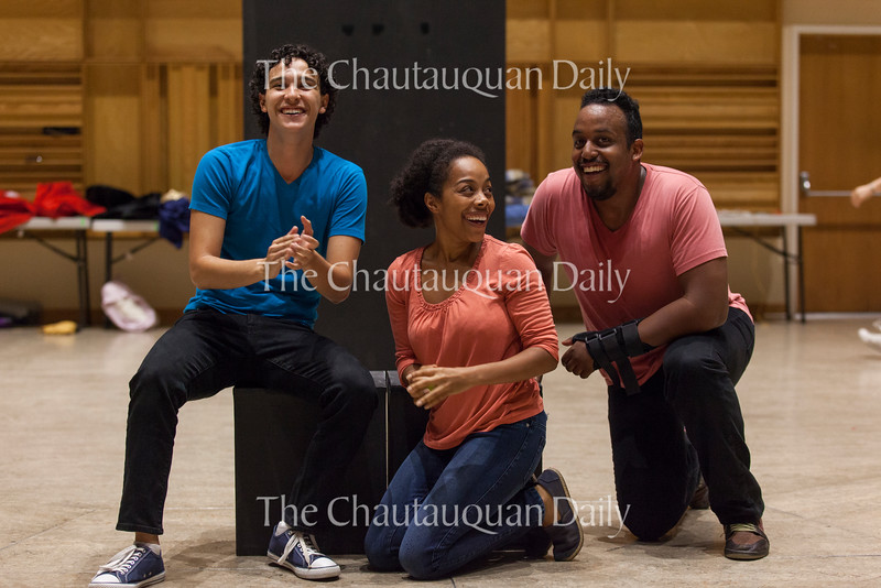 "Left to right: Chautauqua Theatre Conservatory actors Josh Grosso, Brittany Bradford, and David Samuel applaud for playwright Jayson Kell, a third grade student at Fletcher Elementary. Kell's play ""The Riot"" was performed in Lenna Hall on June 20, 2016, as part of the Young Playwrights Festival. The Young Playwrights Festival is part of a collaboration between the Chautauqua Theatre Conservatory and the Florida Studio Theatre."