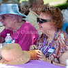 Loretta Bower, left, and Penny Kurtz, right, enjoy the food at the Opera Guild Picnic at noon on July 21, 2016, on the lawn outside Norton Hall. Steven Osgood, Artistic and General Director of Chautauqua Opera Company, addressed the Opera Guild during the picnic, thanking them for their support and discussing the Chautauqua Opera Company's 2017 season. Photo by Carolyn Brown.