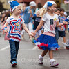 Iyla Vincent, left, five, and Caroline Kilpatrick, right, five, walk together towards the steps of the Colonnade on July 1, 2016, as part of the Children's School's annual Independence Day Parade. Vincent and Kilpatrick joined  the other children and teachers of the Children's School to sing patriotic songs on the Colonnade and show off the patriotic apparel that they had made earlier that week. <br /> <br /> <br /> The parade was held on the Friday before the Fourth of July because the holiday officially falls on a Monday, which would give newcomers to Children's School no time to prepare for the parade. The parade was almost relocated due to rain, but the skies cleared up enough for the children to march to the Colonnade along their traditional parade route. <br /> <br /> Photo by Carolyn Brown.