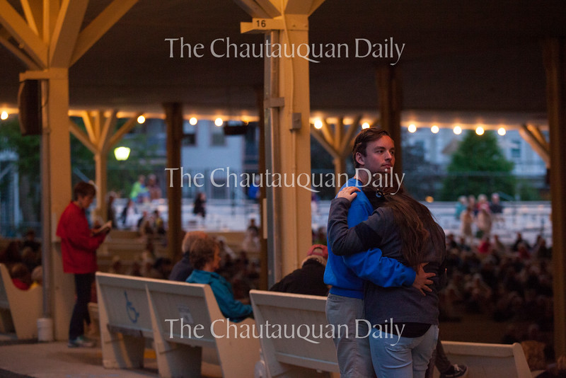 James Snyder and Danielle Katz share a slow dance at the Amphitheater on June 28, 2016. While most of Tiempo Libre's music was lively and upbeat, the band played a slow song in the middle of its set, giving many of the dancing couples at the Amp a break from the more active dancing they did during previous musical numbers.<br /> Photo by Carolyn Brown.