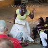 """Mezzo-soprano Tesia Kwarteng performs in the role of The Witch in a piece from Englebert Humperdinck's """"Hansel and Gretel"""" at the Chautauqua Opera's event """"Hojo-To-Jo! To the Opera We Go!"""" at 5 PM on July 19, 2016, at Smith Wilkes Hall.<br /> <br /> <br /> In the piece, Kwarteng's character chases Hansel and Gretel, played by Anthony Ciaramitaro and Margaret Bridge, respectively, around Smith Wilkes.<br /> Photo by Carolyn Brown."""