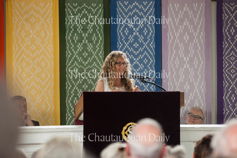 """Author Lily King talks about her book Euphoria during her Chautauqua Literary and Scientific Circle Roundtable presentation at 3:30 PM on Thursday, July 28, 2016, in the Hall of Philosophy. The book is inspired by the life of Margaret Mead, but King said she knew early on that Euphoria had to be a novel, not a biography. <br /> """"I really wanted it to feel real, to be a real experience, not just something that teaches people about a particular time in a person's life,"""" King said.<br /> Part of King's research process involved using index cards, she said.<br /> """"I thought, 'Real researchers get index cards,'"""" King said. """"So, I went to Rite Aid and got a huge stack of index cards. And I wrote out every single note that I thought was important and I put it on an index card.""""<br /> She ended up with a giant pile of material, she said, and realized she was procrastinating. Once she began writing the novel, she said she had to start making the story up on the spot.<br /> """"Part of it was that I felt a little chained to fact,"""" King said. """"The novelist in me was like, 'Let me go! I have things to do here, I can't pay attention to all these facts.'""""<br /> <br /> Photo by Carolyn Brown."""