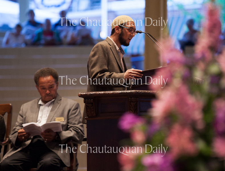 "APYA Muslim Coordinator Yasin Ahmed delivers the adhan, the Muslim call to prayer, <br /> at the Sacred Song Service, ""The Family of Abraham Seeks Courage to Change,"" at 8 PM on July 31, 2016, in the Amphitheater. Ahmed is one of two Muslim Coordinators in the APYA progam. Photo by Carolyn Brown."