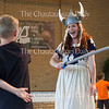 "Oliver Turfler, 8, left, swordfights with soprano Margaret Bridge, right, a Chautauqua Opera Young Artist, during ""Ride of the Valkyries"" from Wagner's ""Die Walküre"" at the Chautauqua Opera's event ""Hojo-To-Jo! To the Opera We Go!"" at 5 PM on July 19, 2016, at Smith Wilkes Hall.<br /> <br /> At the event, Bridge and other members of the Chautauqua Opera Young Artist class of 2016 introduced children to opera by performing famous arias, teaching them opera vocabulary, and involving the audience in the show. Photo by Carolyn Brown."