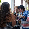 Kristin Currin, left, shows her phone to Linda Steckley, center, and Tina Downey, right, at the Volunteer Recognition Party at 5:30 P.M. on Tuesday, July 26, 2016, on the Athenaeum Hotel Porch. The event included a special presentation by the day's morning lecturer, Nalini Nadkarni. Photo by Carolyn Brown.