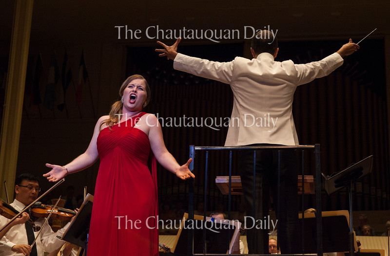 """Soprano Abigail Rethwisch, left, sings """"Was I not a little blade of grass?"""" from Tchaikivsky's """"Seven Romances"""" as conductor Rossen Milanov, right, leads the Chautauqua Symphony Orchestra during the Into the Music Series No. 2: """"Total Tchaikovsky"""" concert on Tuesday, July 26, 2016, in the Amphitheater. Rethwisch had to restart her performance of the piece because she was interrupted by the fire alarm from the Chautauqua Fire Department. Photo by Carolyn Brown."""