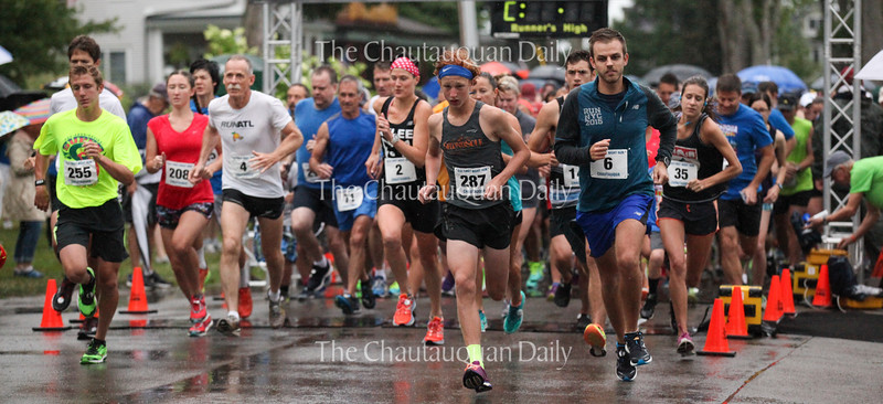 Competitors in the Old First Night race take off from the starting line at 8 A.M. on Saturday, July 30, 2016, outside the Sports Club. Competitor #287, Tyler Clark, center, was the overall winner of the race. Photo by Carolyn Brown.