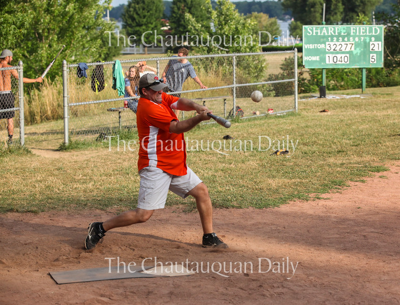 Mike Naimoli hits a softball during a game between the Slugs and the YAC team at 6:30 PM on Friday, July 29, 2016, at Sharpe Field. Photo by Carolyn Brown.