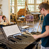 "Alex Myers, left, looks up from carving a porcelain violin as Julian Loida, right, plays John Cage's ""Dream (Music for the Dance by Merce Cunningham)"" on the vibraphone at 3 PM on July 13, 2016, at the School of Art. Loida oversees the Chautauqua Inter-Arts Collective, which brings together students from the Schools of Art, Music, and Dance, to share their work and inspire their peers. This is the first year that the program is student-run."