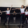 Left to right: Oscar Estep, 11, McKenzie Soares, 13, and Finn Faulconer, 11,  perform in a Ukrainian character dance choreographed by Sarkis Kaltakchian at the Workshop I Studio Show, a performance by Workshop I students in the School of Dance, at 1 PM on July 9, 2016, in Verdy Studio. Kaltakchian said that he likes the way that the piece contrasts the strength of the male dancers with the delicateness of the female dancers.<br /> <br /> Photo by Carolyn Brown.
