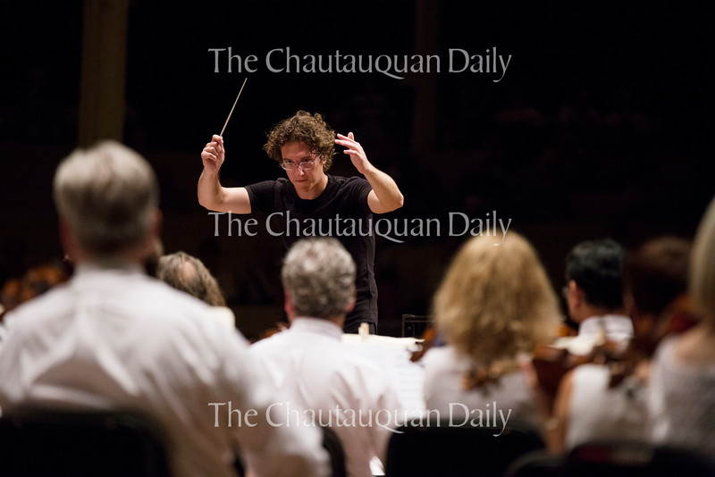 Conductor Teddy Abrams leads the Chautauqua Symphony Orchestra in their 8:15 PM concert on July 14, 2016, at the Amphitheater. Abrams is currently the music director of the Louisville Orchestra in Louisville, KY. Photo by Carolyn Brown.