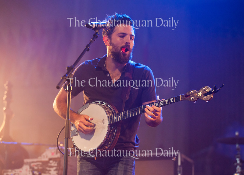 Scott Avett of The Avett Brothers plays the kazoo and banjo at 8:15 PM on July 8, 2016, at the Amphitheater. The show drew a sold-out crowd.<br /> <br /> Photo by Carolyn Brown.